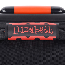 Envoltura de asas del equipaje personalizada con lunares negros y rojos.