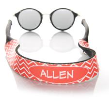 Correa de gafas de sol monogramada con símbolos rojos